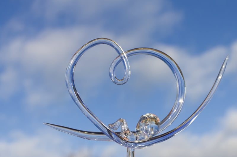 Golfend glazen hart met Baby Sil