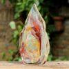 Massief glazen Menhir as rood caramel